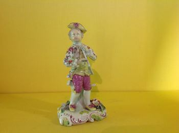A rare Derby 'Pale Family' figure Playing a pipe