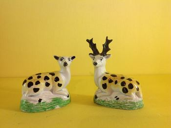 A pair of unusual pearlware models of a stag and doe