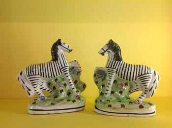 A pair of Scottish pearlware models of zebra