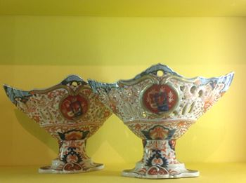 An unusual pair of Japanese Imari pedestal baskets