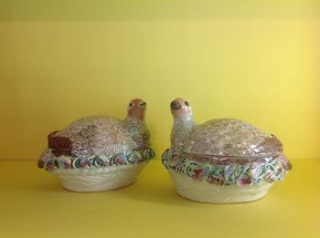 A pair of Worcester partridge shaped tureens and covers