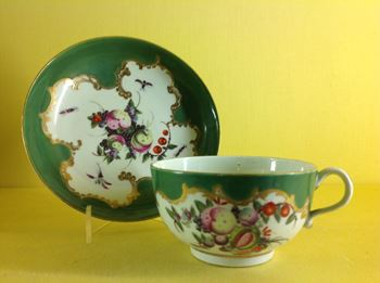 A Worcester green ground teacup and saucer