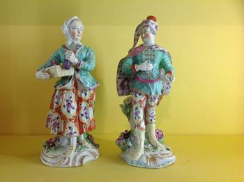 A pair of Derby theatrical figures