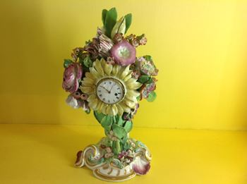 A Chelsea porcelain cased timepiece