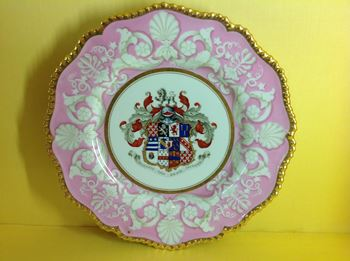 A superb set of twelve Flight, Barr and Barr Worcester armorial dinner plates