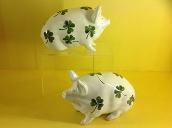 A pair of Wemyss pottery small models of pigs