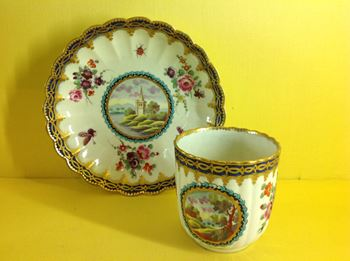 A Worcester fluted coffee cup and saucer