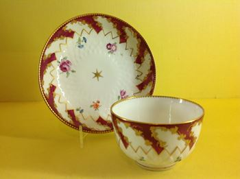 A Chelsea tea bowl and saucer
