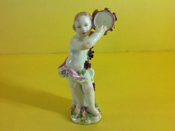 A Chelsea small figure of a putto