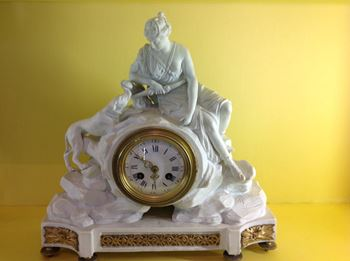 A rare Derby biscuit porcelain cased mantel clock