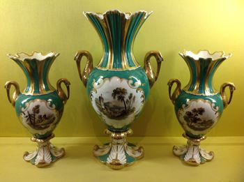 A Rockingham garniture of three vases