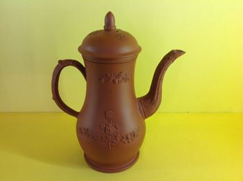 A Staffordshire red stoneware coffee pot and cover