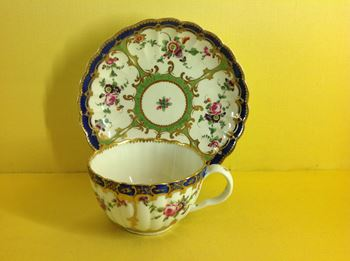 A Worcester fluted teacup and saucer