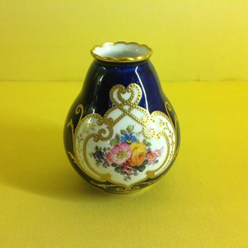 A Royal Crown Derby miniature vase
