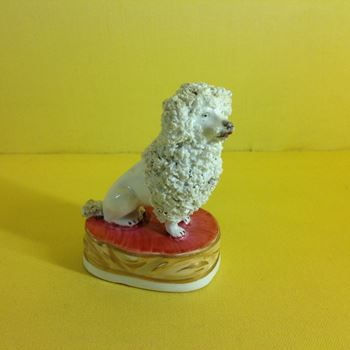 A Staffordshire porcelain model of a poodle