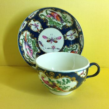 A Worcester tea cup and saucer
