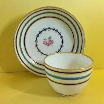 A Derby tea bowl and saucer