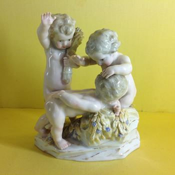 A Meissen group of three putto