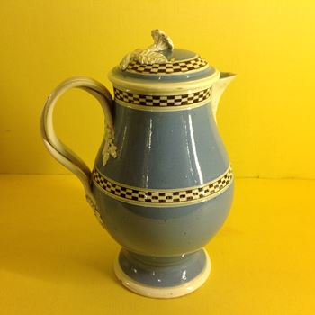A pearlware Mocha Ware milk jug and cover