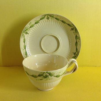 A creamware teacup and saucer