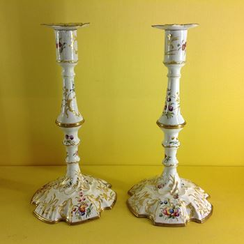 A pair of South Staffordshire enamel candlesticks