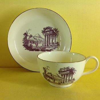 An unusual creamware tea cup and saucer