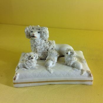 A Staffordshire porcelain poodle and puppies group