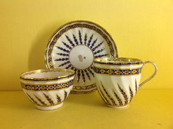 A Derby tea bowl, coffee cup and saucer
