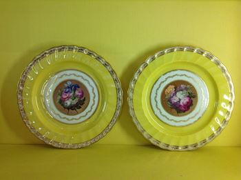 A pair of Derby yellow ground plates