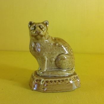 An unusual stoneware small model of a cat