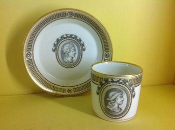 A Vienna coffee can and saucer