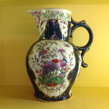 A fine Worcester large cabbage leaf moulded jug