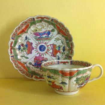 A Worcester tea cup and saucer