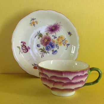 An unusual English Porcelain tea cup and saucer
