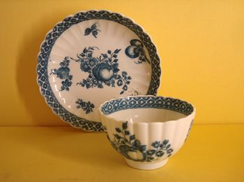 A Caughley teabowl and saucer