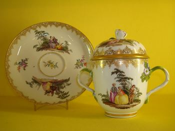 A Meissen chocolate cup, cover and saucer