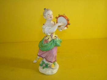 A Meissen figure of a young girl