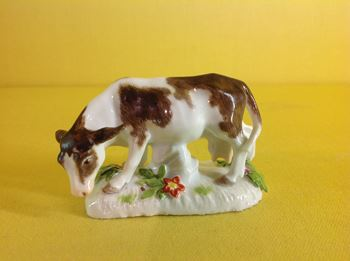 A Meissen miniature model of a cow