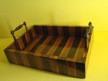 A Regency rosewood and yew wood small tray