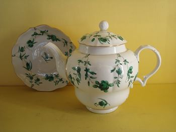 A fine and rare Bristol teapot cover and stand