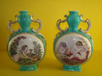 A pair of Chelsea moon flask shaped vases