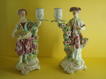 A pair of Derby candlestick figures