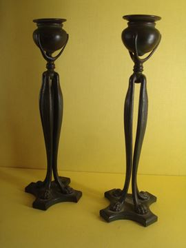 A pair of Tiffany bronze candlesticks
