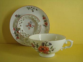 A rare Derby cup and trembleuse saucer