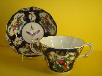 A rare Worcester ogee shaped chocolate cup and saucer